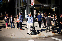 People watch as OccupyBoston marches through the streets of Back Bay, a high-traffic shopping area, in Boston, Massachusetts, USA. The protesters are part of  OccupyBoston, which is part of the OccupyWallStreet movement, expressing discontent with the socioeconomic situation of the 99% of the US population who are not wealthy.  Protestors have been camping in Dewey Square since Sept. 30, 2011. Gradually, larger organizations, including major labor unions, have expressed their support for the OccupyBoston effort.
