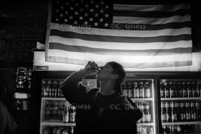 A man throws back one more shot before leaving a bar in Austin, Texas on Monday, March 3, 2008 during the 2008 Texas Presidential Primaries.