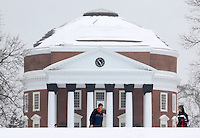 UVa students walk on the snow covered lawn area in front of the Rotunda at the University of Virginia Thursday after a snowfall in Charlottesville, VA. Photo/Andrew Shurtleff