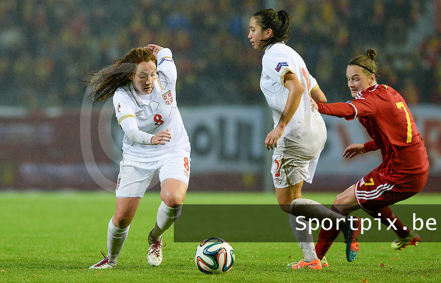 20151130 - LEUVEN ,  BELGIUM : Serbian Marija Ilic (left) pictured with Serbian Jasna Djordjevic (middle) and Belgian Elke Van Gorp (r) during the female soccer game between the Belgian Red Flames and Serbia , the third game in the qualification for the European Championship in The Netherlands 2017  , Monday 30 November 2015 at Stadion Den Dreef  in Leuven , Belgium. PHOTO DAVID CATRY