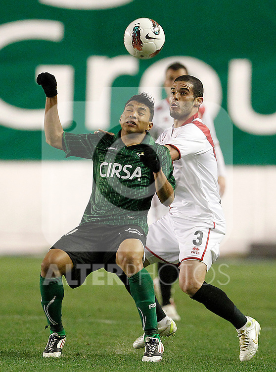 Rayo Vallecano's Jose Manuel Casado (r) and Betis' Jefferson Montero during La Liga match.March 17,2012. (ALTERPHOTOS/Acero)