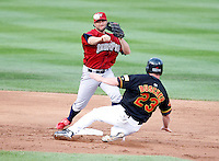 August 3, 2009:  Second Baseman David Newhan of the Lehigh Valley IronPigs attempts to turn a double play as Brian Boushier slides in during a game at Frontier Field in Rochester, NY.  Lehigh Valley is the International League Triple-A affiliate of the Philadelphia Phillies.  Photo By Mike Janes/Four Seam Images