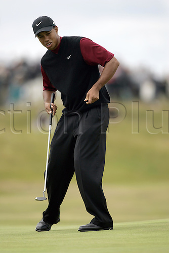 18 July 2004:  American golfer TIGER WOODS (USA)  putts on the 4th green during the final round of The Open Championship played at Royal Troon, Scotland. Photo: Glyn Kirk/Action Plus...golf putt putting putter 040718