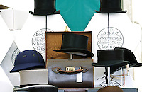 Antique silk top hat and case with other hats at Lock and Co. stall at Windsor Horse Show