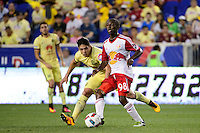 Harrison, NJ - Wednesday July 06, 2016: Shaun Wright-Phillips, Javier Guemez during a friendly match between the New York Red Bulls and Club America at Red Bull Arena.