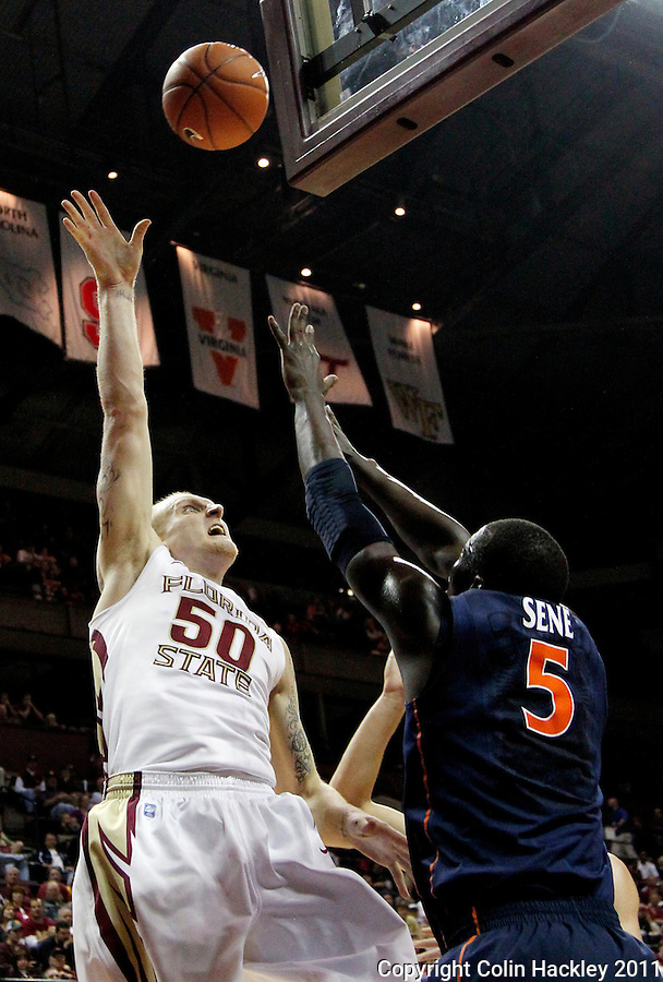TALLAHASSEE, FL 10-FSU-VA MBB11 CH-Florida State's Jon Kreft shoots over Virginia's Assane Sene during second half action Saturday at the Donald L. Tucker Center in Tallahassee. The Seminoles beat the Cavaliers 63-56...COLIN HACKLEY PHOTO
