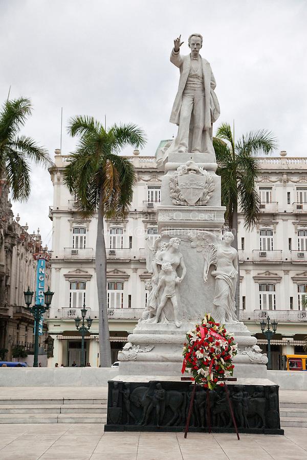 Cuba, Havana.  Statue of Jose Marti.  Hotel Inglaterra in Background.