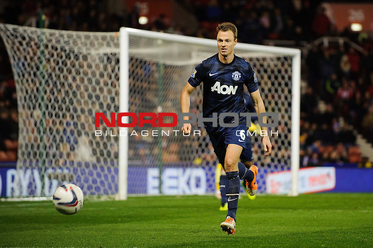 Man Utd Defender Jonny Evans (NIR) in action during the second half of the match -  - 18/12/2013 - SPORT - FOOTBALL - Britannia Stadium, Stoke - Stoke City v Manchester United - Capital One Football League Cup Quarter-Final.<br /> Foto nph / Meredith<br /> <br /> ***** OUT OF UK *****