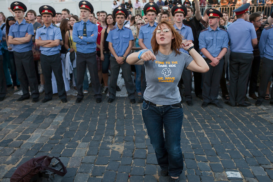 Moscow, Russia, 23//06/2011..A fan dances in front of police lines as American band Linkin Park perform by Red Square to mark the world premiere in Moscow of the new Michael Bay movie Transformers: Dark Of The Moon.