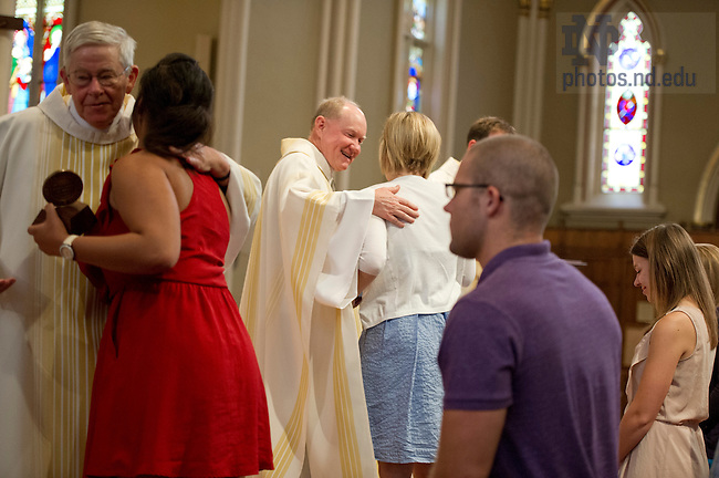 July 26, 2013;  Rev. Timothy Scully, C.S.C., gives medals to ACE teachers during the annual Missioning Mass at the Basilica of the Sacred Heart. Photo by Barbara Johnston/University of Notre Dame