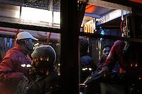 Profughi di guerra e richiedenti asilo politico sudanesi, eritrei e somali, conclusa la trattativa con le istituzioni, vengono portati in ricoveri temporanei. Milano, 29 dicembre,  2005<br /> <br /> Sudanese, Somali and Eritrean war refugees and asylum seekers, ended the negotiation with the institutions, are brought in temporary shelters. Milan, December 29, 2005