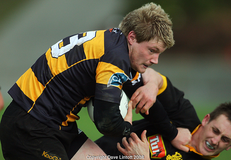 Taranaki's Jonathan Spratt fends off Michael Hobbs..Air NZ Cup pre-season match. Wellington v Taranaki at Porirua Park, Wellington, New Zealand, Friday, 11 July 2008. Photo: Dave Lintott/lintottphoto.co.nz