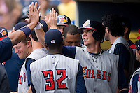 Brent Clevlen #24 of the Toledo Mudhens is high-fived by his teammates after hitting a 2-run home run in the top of the first inning at Harbor Park June 7, 2009 in Norfolk, Virginia. (Photo by Brian Westerholt / Four Seam Images)
