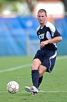 10 September 2011:  FIU's Joseph Dawkins (4) passes the ball in the first half as the FIU Golden Panthers defeated the Stetson University Hatters, 3-2 in the second overtime period, at University Park Stadium in Miami, Florida.