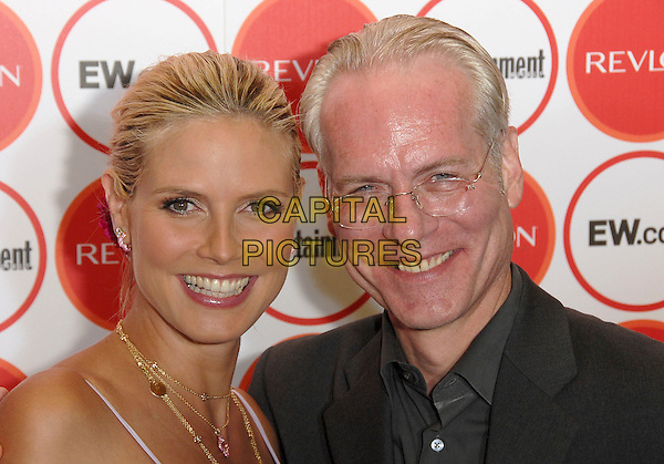 HEIDI KLUM & TIM GUNN.attends The Entertainment Weekly Pre-Emmy Party held at Republic in West Hollywood, California, USA,.August 26, 2006..portrait headshot pregnant long white lilac dress pink flower in hair clip gold necklace jewellery .Ref: DVS.www.capitalpictures.com.sales@capitalpictures.com.©Debbie VanStory/Capital Pictures