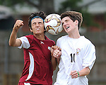 Two players battle for the ball during soccer play at Lafreniere.
