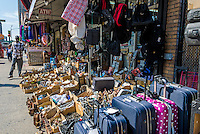 New York, NY - 7 July 2014 - Hardware, luggage, iPhone covers and other random items displayed on the sidewalk outside a Canal Street store. ©Stacy Walsh Rosenstock/Alamy