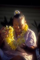 Auntie Flo stringing plumeria lei