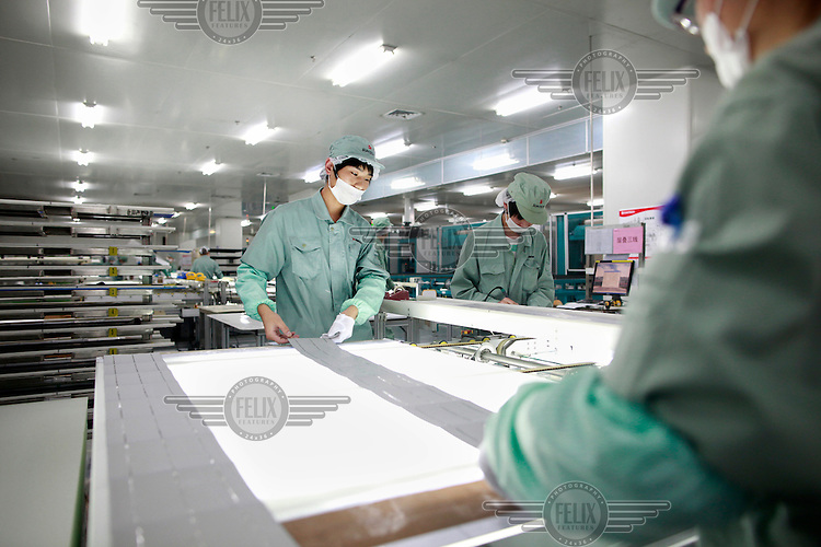 Scientists at work at the Suntech factory, the world's largest producer of solar panels.
