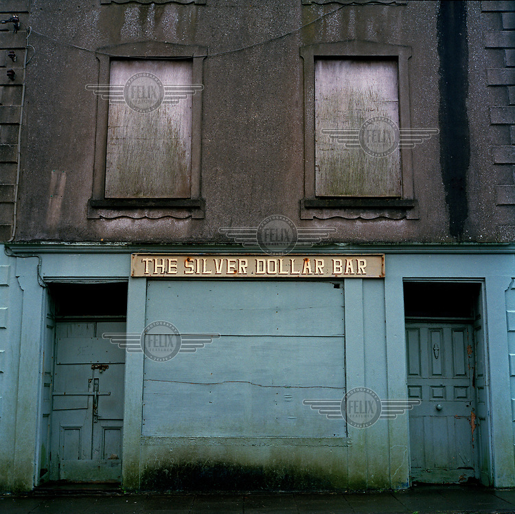 The Silver Dollar Bar, now boarded up and disused.