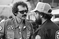 DAYTONA BEACH, FL - FEBRUARY 14: Richard Petty (left), driver of the Petty Enterprises Pontiac, speaks with Maurice Petty in the garage area before practice for the NASCAR Winston Cup race at the Daytona International Speedway in Daytona Beach, Florida, on February 14, 1982.