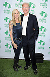 """Ed Begley Jr. and date at the """"Global Green USA's Annual Millennium Awards"""" held at Fairmont Miramar Hotel in Los Angeles, Ca. on June 8, 2013."""
