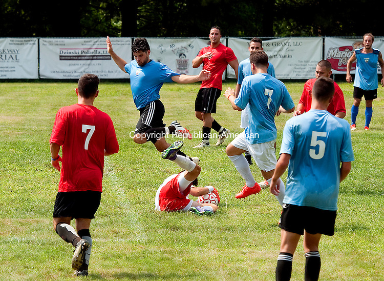 WATERBURY,  CT--- -080616JS04-A player jumps over the goal keeper as he makes a save during a soccer game during the annual Festa di San Donato held Saturday at the Pontelandolfo Community Club in Waterbury. The festival continues through today (Sunday) beginning with a Roman Catholic Mass and Procession beginning at St. Lucy&rsquo;s Church at 10:15 a.m.<br /> Jim Shannon Republican American