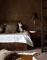 Even the child's room comes straight out of Africa, its walls and sofa bed clad in faux hide