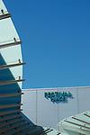 Close up of exterior of Festival Place shopping centre against blue sky, Basingstoke, Hampshire