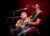 Ramstein AFB, Germany - December 16, 2008 -- Grammy award winning musician Kid Rock, right, and his guitarist Zac Brown, left, perform for service members during the 2008 USO Holiday Tour stop at Ramstein Air Force Base, Germany on Tuesday, December 16, 2008.  Tour host United States Navy Admiral Mike Mullen, chairman of the Joint Chiefs of Staff and his wife Deborah were joined by, along with Rock, comedians John Bowman, Lewis Black and Kathleen Madigan; actress Tichina Arnold and American Idol contestant and country musician Kellie Pickler on the tour bringing joy to service members and their families stationed overseas. .Credit: Chad J. McNeeley - DoD via CNP