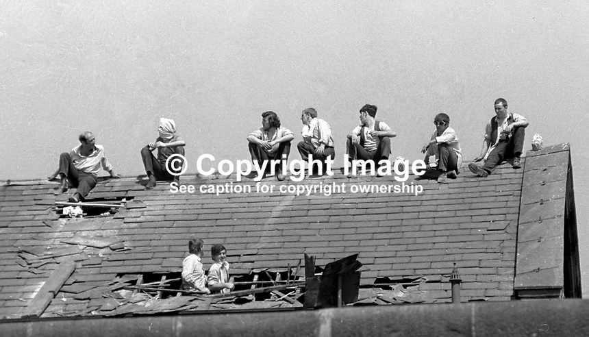 Prisoners protesting on the rooftop of the Crumlin Road Jail, Belfast, N Ireland, 20 July 1972 take advantage of the July sunshine. During the rooftop protest one prisoner was wounded by a shot from a sniper. MORE CAPTION INFO TO FOLLOW. 197207200419a Copyright Image from Victor Patterson, 54 Dorchester Park, <br />