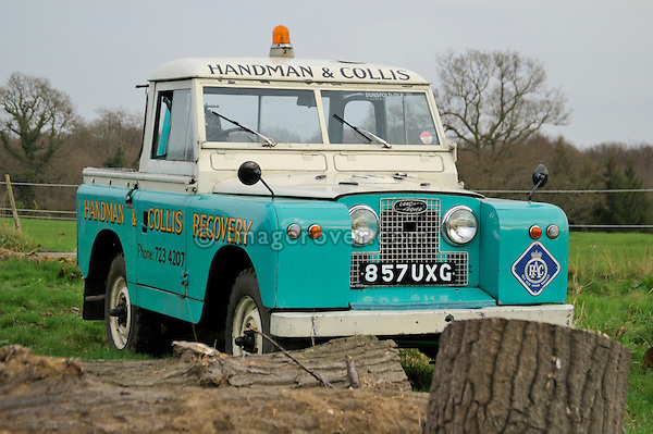 Front view of 1958 2.0 Liter Diesel Land Rover Series 2 SWB 88 recovery truck with Harvey Frost crane in very original condition with two colour paint sheme in light blue and white showing the golden company name Handman & Collis Recovery. UK 2005 Dunsfold.