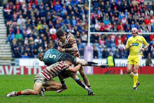 03.04.2015.  Wigan, England.  Super League Rugby. Wigan Warriors versus St Helens. Adam Swift of St Helens dives through a tackle