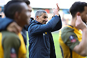 17th March 2019, The Den, London, England; The Emirates FA Cup, quarter final, Millwall versus Brighton and Hove Albion; Brighton & Hove Albion manager Chris Hughton applauding the Brighton & Hove Albion fans after full time as they book a place into the FA Cup Semi Final