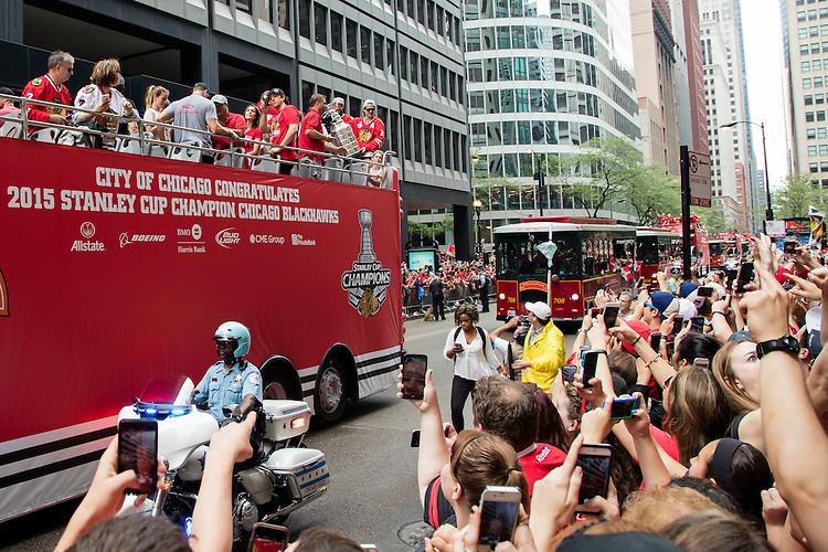 Patrick Sharp, #10 left wing, shows off the Stanley Cup to hundreds of thousands of fans as the 2015 Stanley Cup champion Chicago Blackhawks bring their third cup to Chicago in six seasons. The city of Chicago threw its dynasty a parade and rally in their honor June 18. The parade, which started on the west side of the city and caravanned through the Loop, will end with a rally at Soldier Field. (DePaul University/Jeff Carrion