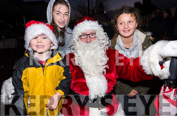 Jim and Eileen O'Connor (Dingle) with Yasmina Beaujouan (Stradbally) meeting Santa during Féile na Soilse in Dingle on Sunday evening.