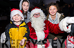 Jim and Eileen O'Connor (Dingle) with Yasmina Beaujouan (Stradbally) meeting Santa during Féile na Soilse in Dingle on Sunday evening.