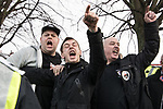 © Joel Goodman - 07973 332324 . 20/01/2018. Doncaster, UK. EDL supporters shout at anti-fascist counter protesters and members of the local community . Far-right street protest movement , the English Defence League ( EDL ) march through Hexthorpe after holding a demonstration , opposed by anti-fascists , including Unite Against Fascism ( UAF ) in the Hexthorpe area of Doncaster . EDL supporters chanted anti-Roma slogans as they marched through the town . Photo credit : Joel Goodman