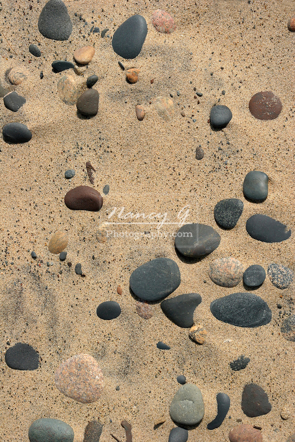 Many washed up rounded stones on the shoreline of Lake Superior in Upper Michigan
