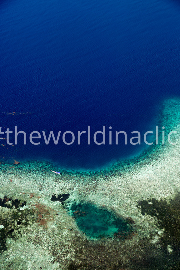 INDONESIA, Flores, flight from Bali to Flores, fishing boat on a coral reef in the Indian Ocean