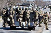 NWA Democrat-Gazette/DAVID GOTTSCHALK Members of a law enforcement tactical team return after taking Dekota Harvey, 22, into custody Friday, March 15, 2019  around 10;30 a.m. at the Applegate Apartment complex in Springdale. Fayetteville police said Harvey, 22, was wanted in connection with a Thursday night shooting that left one person dead and a second hospitalized. The shooting happened in the 900 block of North Leverett Avenue, according to police. Officers were called to a report of a disturbance in the area at 9:12 p.m. An ambulance was dispatched to the area at 9:16 p.m.