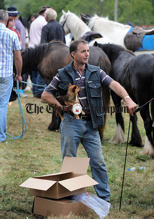 Selling four legged friends of another variety  at Spancilhill Fair. Photograph by John Kelly