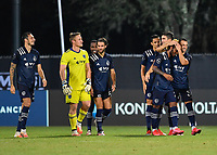 LAKE BUENA VISTA, FL - JULY 26: Gianluca Busio of Sporting KC is embraced by Luis Martins of Sporting KC following his clinching shootout goal during a game between Vancouver Whitecaps and Sporting Kansas City at ESPN Wide World of Sports on July 26, 2020 in Lake Buena Vista, Florida.
