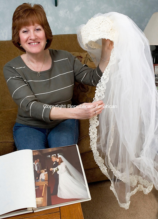 TORRINGTON, CT- 12 APRIL 2008- 041208JT10-<br /> Jane Yurgalevicz shows a picture from her wedding in 1977 at St. Paul's Church in Torrington, where she wears a 10-foot veil, as she holds an entirely different veil that was professionally boxed with her wedding dress. Yurgalevicz is searching for the veil that she wore on her wedding day to give to her daughter Amy, who is getting married in July 2009.<br /> Josalee Thrift / Republican-American