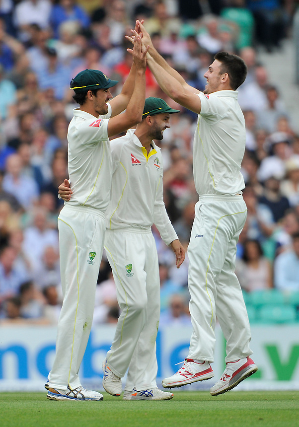 Australia's Mitchell Marsh (right) celebrates taking the wicket of England's Jos Buttler for 42 caught by Mitchell Starc<br /> <br /> Photographer Ashley Western/CameraSport<br /> <br /> International Cricket - Investec Ashes Test Series 2015 - Fifth Test - England v Australia - Day 4 - Sunday 23rd August 2015 - Kennington Oval - London<br /> <br /> &copy; CameraSport - 43 Linden Ave. Countesthorpe. Leicester. England. LE8 5PG - Tel: +44 (0) 116 277 4147 - admin@camerasport.com - www.camerasport.com