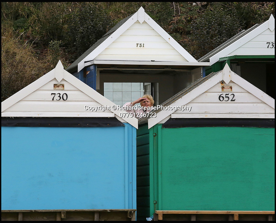 """BNPS.co.uk (01202 558833)<br /> Pic: RichardCrease/BNPS<br /> <br /> Gillian Vincent struggles to see the sea.<br /> <br /> Beach hut owners fury after sea views are blocked...by more beach huts.<br /> <br /> Irate beach hut owners have slammed a council who have allowing a row of beach huts to be built directly in front of them blocking their beautiful sea views.<br /> <br /> Owners who pay £1,094 a year to the council to have a beach hut there will instead have to make do with the view of the back of another beach hut.<br /> <br /> Furious owners in the Manor Steps area in Bournemouth, Dorset, are demanding action after being told of plans to place more huts between them and the beach by the end of the month.<br /> <br /> They claim their views of the sea, beach and prom will be completely blocked and that the council has not consulted them on the plans.<br /> <br /> Bournemouth Borough Council said the move is necessary to allow for the creation of a turning circle for the newly-routed land train.<br /> <br /> Mrs Vincent, who has owned a beach hut for more than 50 years, said: """"What's the point of owning a beach hut if all you can see is the back of another hut?"""
