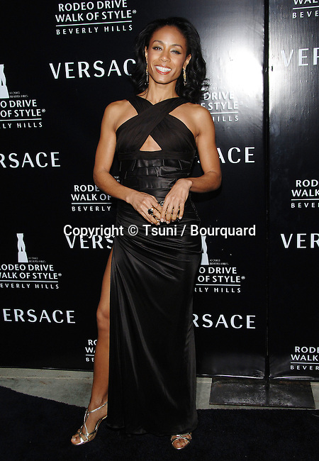 Jada Pinkett-Smith arriving at the WALK OF STYLE Awards to Versace at the City Hall in Beverly Hills.<br /> <br /> full length<br /> black dress<br /> smile<br /> eye contact