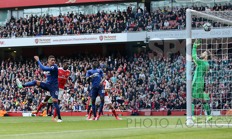 Arsenal's Danny Welbeck scoring hiis sides second goal during the Premier League match at the Emirates Stadium, London. Picture date: May 7th, 2017. Pic credit should read: David Klein/Sportimage