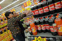 A Coca-Cola propotion a super-market in Beijing, China. Coke is trying to change the drinking habits of the Chinese as they continue to make efforts to win a larger share of the lucrative Chinese market..01 Mar 2008