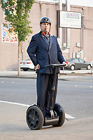 Man is Suit Riding Segway, Renton City Comicon 2017, Washington, USA.